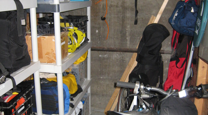 organized shelvs filled with sporting gears, room for bike and walk through